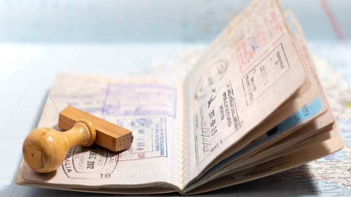 An open passport displaying pages with many stamps on them